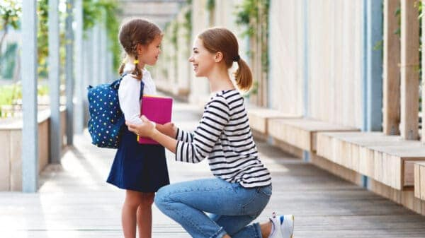 Mother dropping of child at school