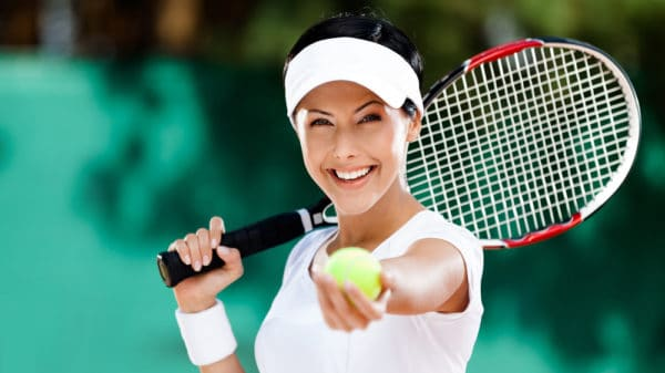 Healthy woman playing tennis