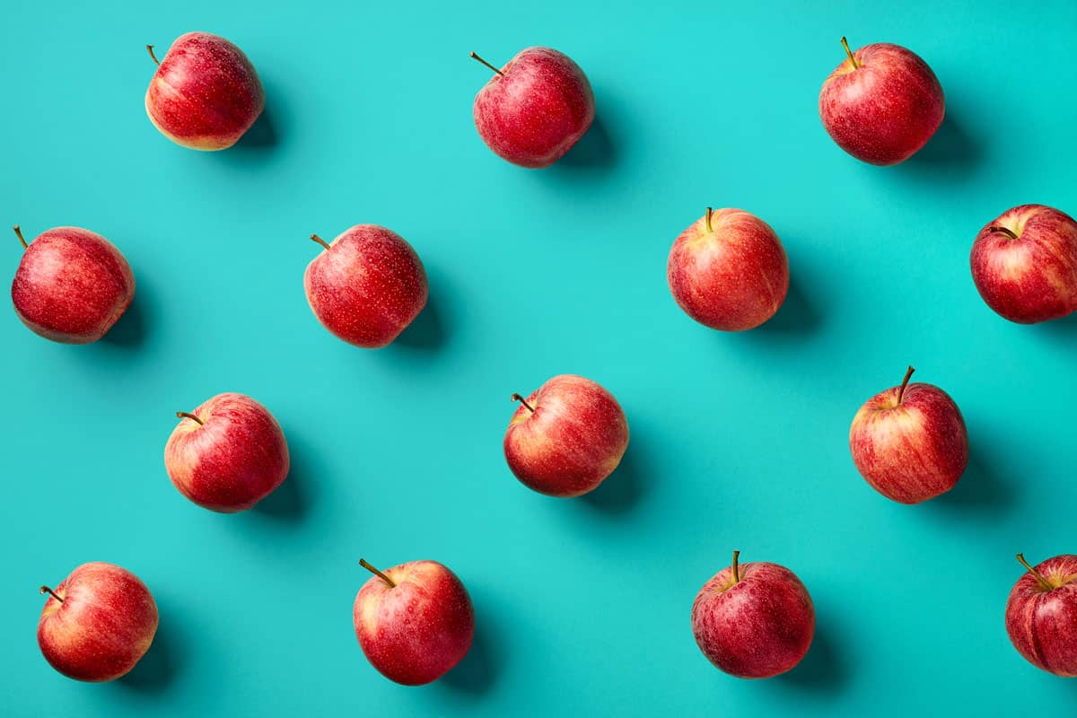 Quercetin apples on a blue background
